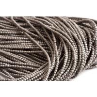 Hematite, rund, facet, mat, sølvfarvet, 2 mm, 1 streng
